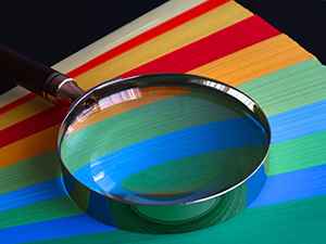 Magnifying glass over color swatches